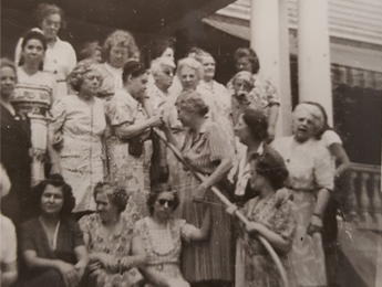 Group of Women Standing and Sitting On Steps